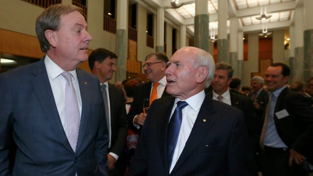 Former treasurer Peter Costello and former prime minister John Howard celebrate the 20th anniversary of Howard's 1996 ...