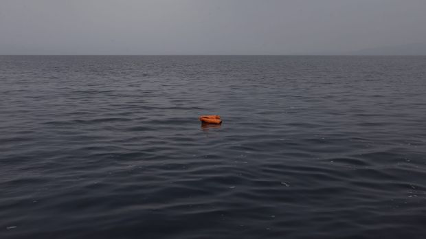 An abandoned lifejacket on the Aegean Sea.