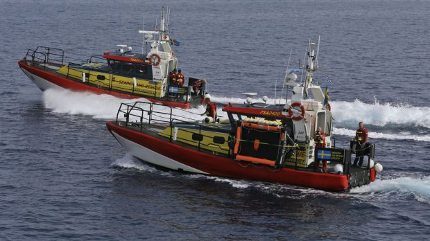 Members of the Swedish Sea Rescue Society patrol the Aegean Sea, between the eastern Greek Island of Agathonisi and ...
