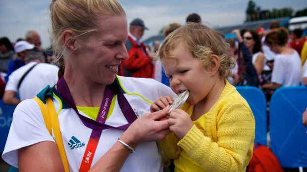 Sarah Tait shows off her medal to daughter Leila after winning silver at Eton Dorney.