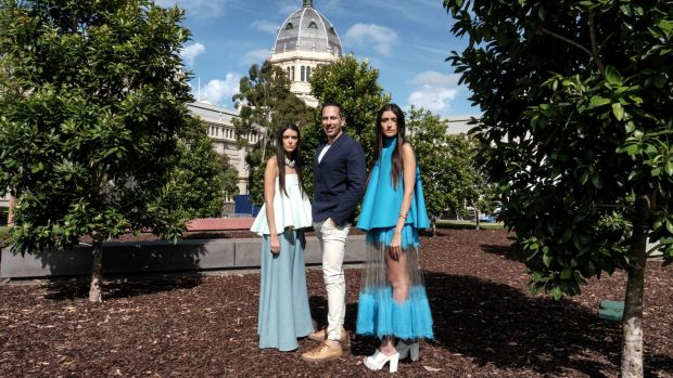 Virgin Australia Melbourne Fashion Festival CEO Graeme Lewsey with bloggers Jess and Stef Dadon, who are wearing designs ...