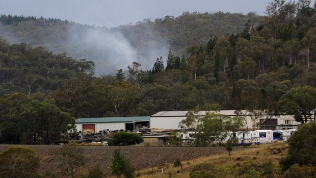 A fire burns at the rear of Queanbeyan in Kowen Pine Forest.