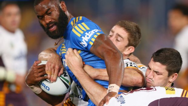 Tough night: Eels winger Semi Radradra is held back.