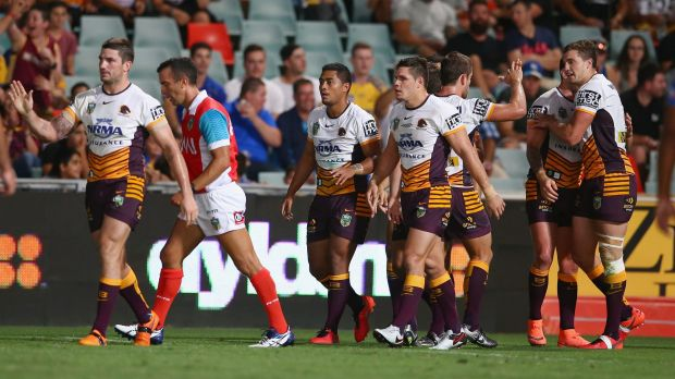 Impressive win: Anthony Milford celebrates with his teammates after scoring a try during the round one NRL match between ...