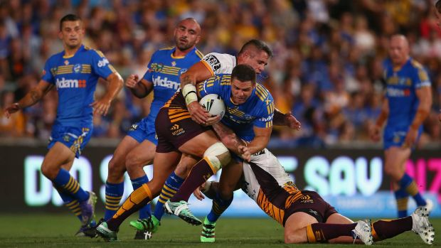 Flash: Michael Gordon is stopped by Brisbane Broncos in the Eels' season opening match.