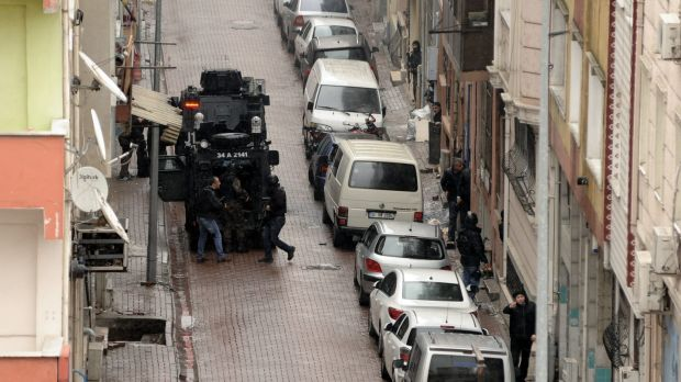 Security forces take up positions during the operation against two female militants in Istanbul.