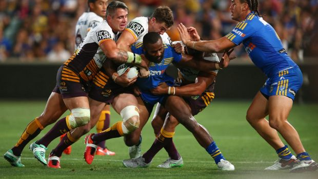 Going nowhere: Semi Radradra is wrapped up by a trio of Broncos.