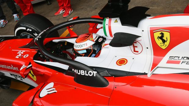 Kimi Raikkonen returns to the garage after testing the new halo head protection system.