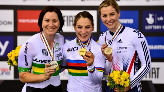 Kristina Vogel of Germany (centre) celebrates winning a gold medal in the keirin, with Australian Anna Meares (left)  ...