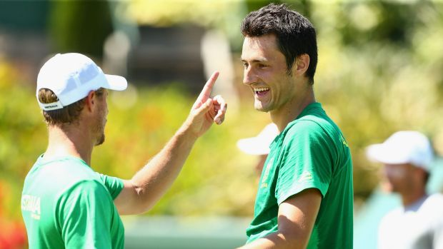 Lleyton Hewit  speaks with Bernard Tomic of Australia during a practice session ahead of the Davis Cup Tie between ...