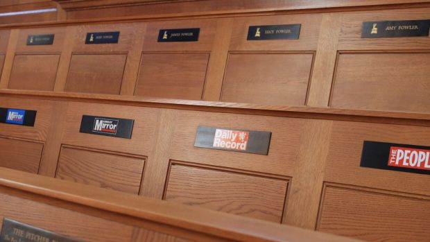 St Bride's pews are badged with the mastheads of some of Britain's best known publications.
