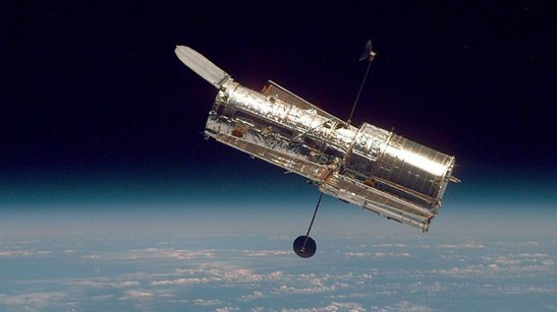 The Hubble Space Telescope hovers at the boundary of Earth and space in 1997.