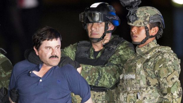 "Joaquin ""El Chapo"" Guzman is made to face the press as he is escorted by Mexican soldiers and marines in Mexico City in ..."