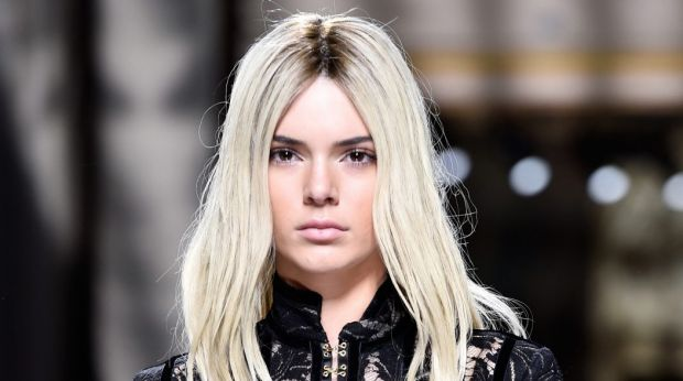 Kendall Jenner rocks platinum blonde hair during the Balmain show at Paris Fashion Week on Thursday.