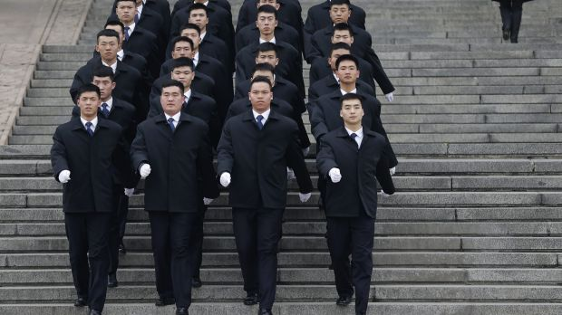 Soldiers dressed as ushers march out of the Great Hall of the People during on Thursday.