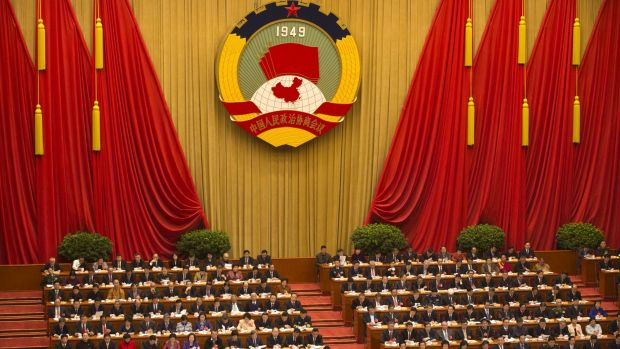 Delegates listen to a speech during the opening session of the Chinese People's Political Consultative Conference in ...