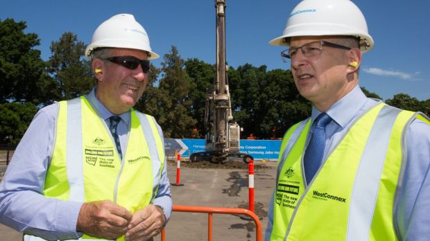 Federal Minister for Major Projects Paul Fletcher, right, said the government was already looking at a system of road ...