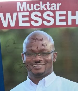 One of Mucktar Wesseh's vandalised election corflutes.