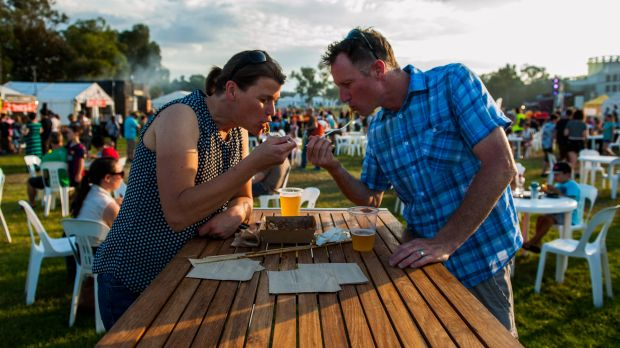 Erica Collins and Simon Bartle enjoy Japanese noodles at the first night of the Night Noodle Market.
