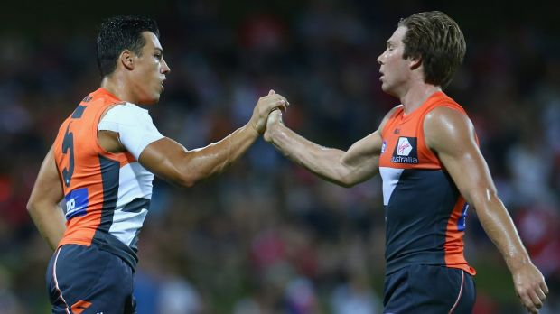 Dylan Shiel of the Giants and teammate Toby Greene acknowledge each other's efforts after a goal.