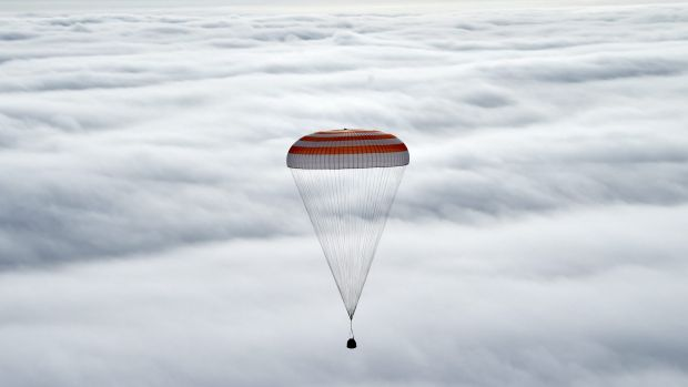 Russia's Soyuz TMA-18M space capsule carrying the International Space Station (ISS) crew of US astronaut Scott Kelly and ...