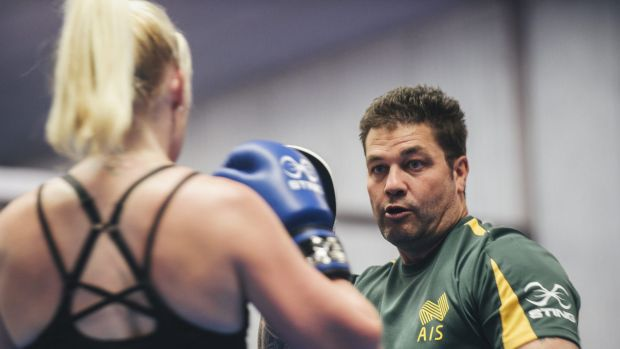 Mix 'n'match: Boxing Australia coach Paul Perkins has been working with Paralympic rower Kathryn Ross.