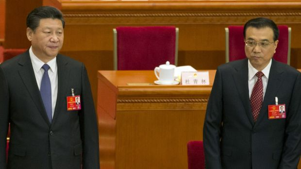 Chinese President Xi Jinping, left and Chinese Premier Li Keqiang at the annual National People's Congress on Saturday.