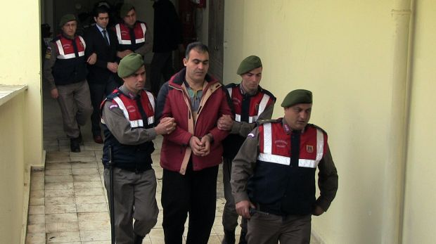 Turkish paramilitary police officers escort Syrian smugglers Muwafaka Alabash, front, and Asem Alfrhad, rear. for their ...