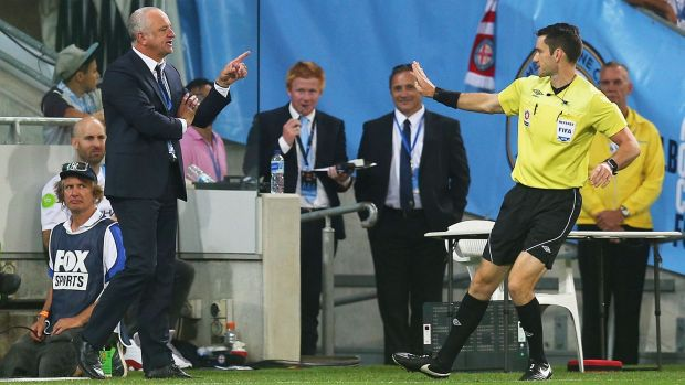 Sydney FC coach Graham Arnold offers referee Jarred Gillett a few helpful tips.