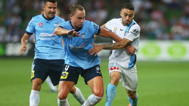 Anthony Caceres of Melbourne City and Zachary Anderson of Sydney FC compete for possession.