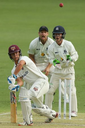 Mitchell Swepson of Queensland bats on day one of the Sheffield Shield match against Victoria at The Gabba.