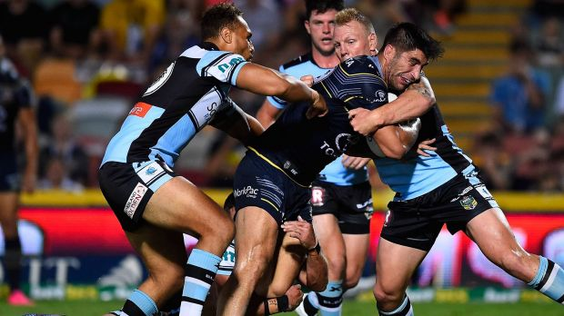 Going nowhere: James Tamou of the Cowboys is wrapped up by the Sharks' defence.
