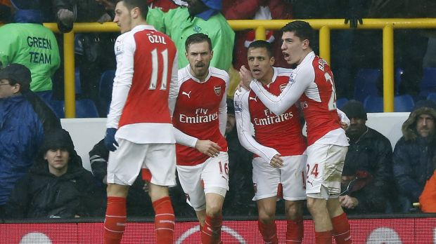 Arsenal's Alexis Sanchez, second right, celebrates after scoring his side's second goal.