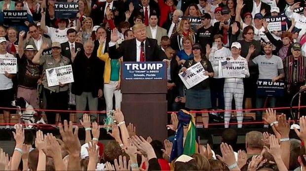 Donald Trump asks supporters to pledge their allegiance to him during a rally in Florida.