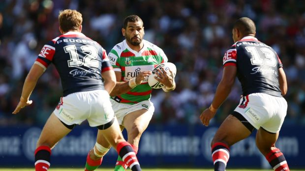 Hard to stop: Greg Inglis takes on the defence during the round one NRL match between the Sydney Roosters and the South ...