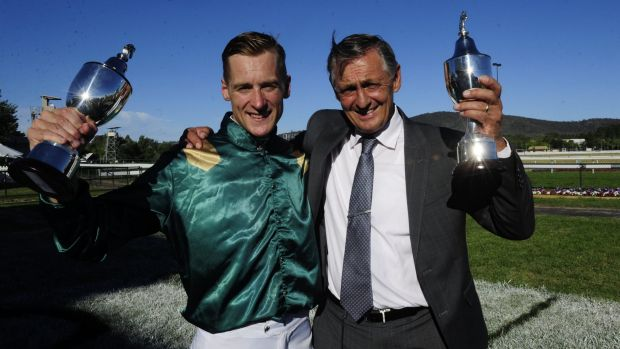 Jockey Blake Shinn and trainer Peter Snowden celebrate Defcon's win in the Black Opal Stakes.