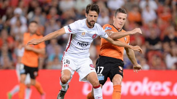 Tangle:  Andreu is challenged by Matt McKay during the round 22 A-League match between the Brisbane Roar and the Western ...