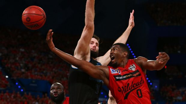 Up he goes: Jermaine Beal lays up against Alex Pledger during game three of the NBL Grand Final series between the Perth ...