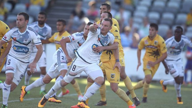 Goal rush: Victory striker Besart Berisha tries to escape the attention of Central Coast's defence.