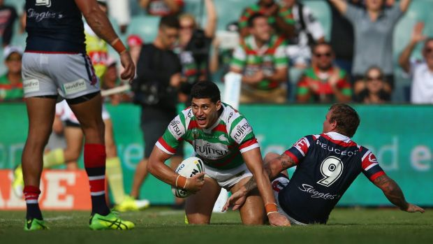 Over he goes: Kyle Turner celebrates scoring a try during the round one NRL match between the Sydney Roosters and the ...