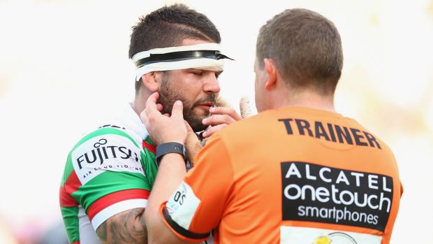 In a world of hurt: Adam Reynolds receieves attention from the trainer.