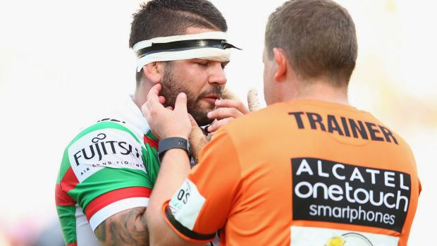 Adam Reynolds gets attention for a jaw injury suffered in the Rabbitohs clash with the Roosters on Sunday.