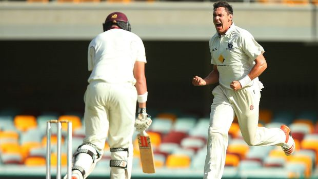 Out-paced:  Scott Boland celebrates after dismissing Queensland's Matthew Renshaw.