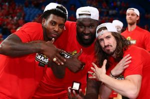 Rings: Casey Prather, Nate Jawai and Greg Hire.