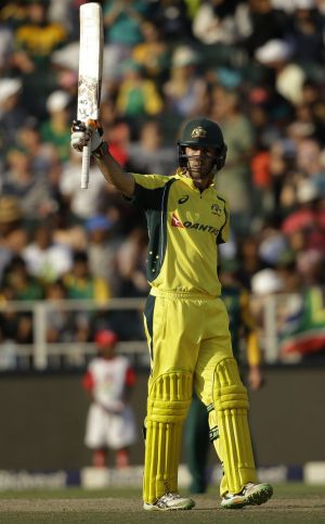 Glenn Maxwell raises his bat after reaching his half century.