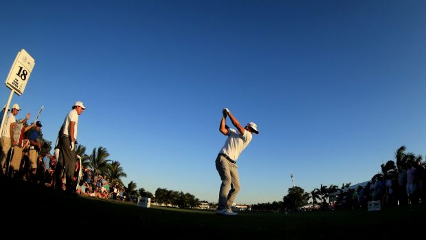 Nearly in the water: Scott of Australia tees off on the final hole.