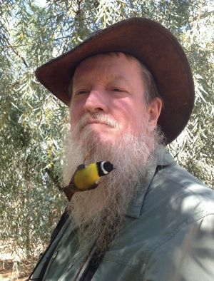 Canberra naturalist Ian Fraser and, yes, that is a bird in his beard.