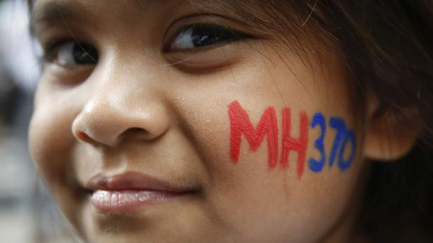 A Malaysian child has her face painted with MH370 during a remembrance event to mark the second anniversary of the jet's ...