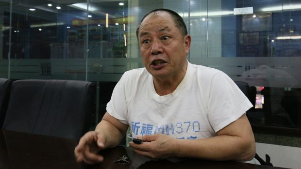 "Wen Wancheng's T-shirt is a poignant reminder of his 34-year-old son: ""Pray for the safe return of MH370,"" it says."