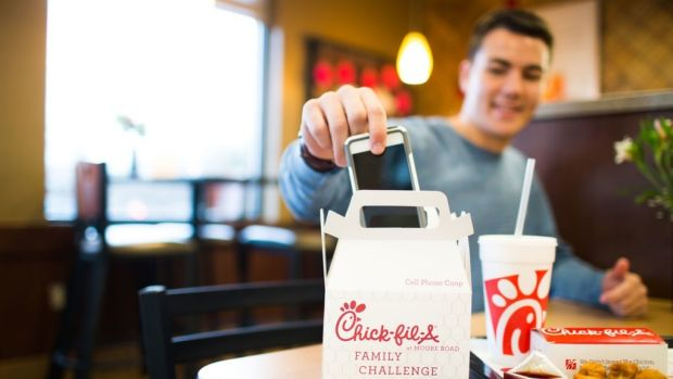 "The ""phone coop"" box designed by a Chick-fil-A franchisee keeps phones out of sight during the meal."